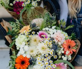 Girl carrying a basket full of flowers Stock Photo 01