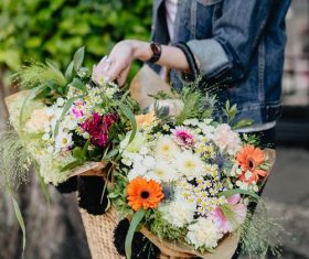 Girl carrying a basket full of flowers Stock Photo 03