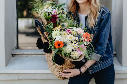 Girl carrying a basket full of flowers Stock Photo 04