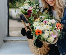 Girl carrying a basket full of flowers Stock Photo 05