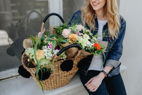Girl carrying a basket full of flowers Stock Photo 06