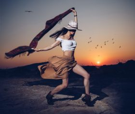 Girl dancing in the sunset Stock Photo