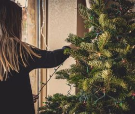 Girl decorating christmas tree Stock Photo 01