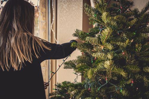 Girl decorating christmas tree Stock Photo 01