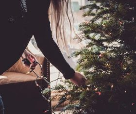 Girl decorating christmas tree Stock Photo 02