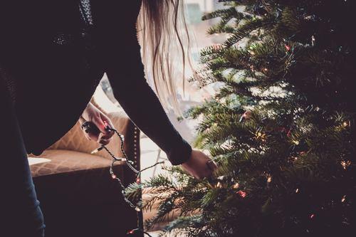 Girl decorating christmas tree Stock Photo 02
