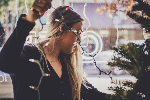 Girl decorating christmas tree Stock Photo 04