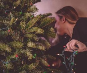 Girl decorating christmas tree Stock Photo 06