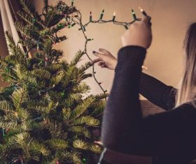 Girl decorating christmas tree Stock Photo 07