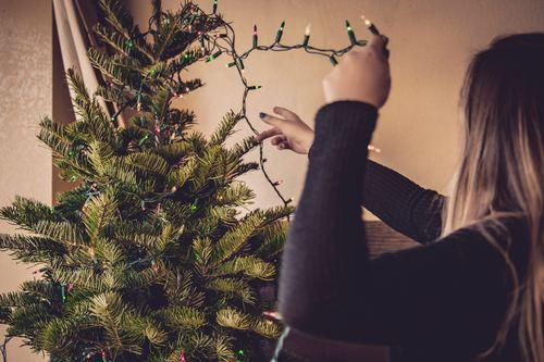 Girl decorating christmas tree Stock Photo 07