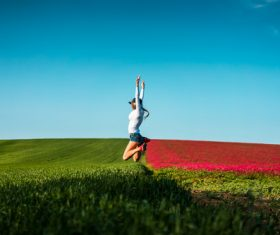 Happy Woman Jumping in the Air Stock Photo