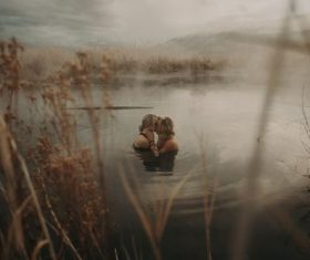 Intimate lovers in the water Stock Photo