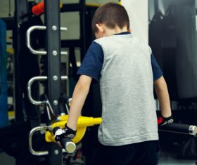 Little boy doing physical exercise Stock Photo
