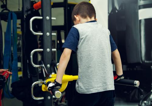 Little boy doing physical exercise Stock Photo