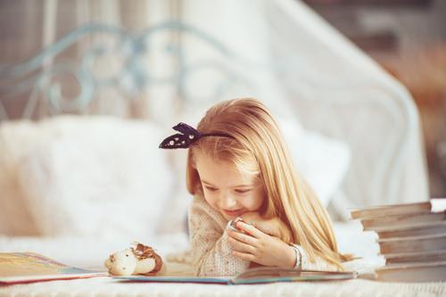 Little girl reading fairytale book Stock Photo