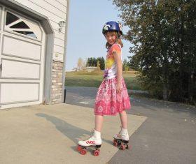 Little girl rollerblading Stock Photo