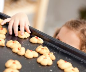 Little girl takes freshly baked cookies Stock Photo 01