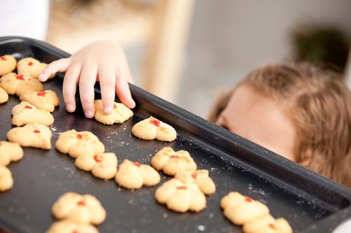 Little girl takes freshly baked cookies Stock Photo 01