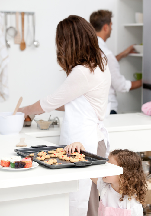 Little girl takes freshly baked cookies Stock Photo 02