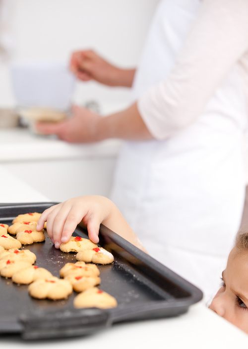 Little girl takes freshly baked cookies Stock Photo 03