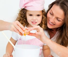 Mother and daughter making cookies together Stock Photo 01