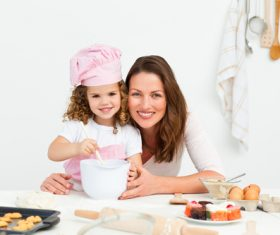 Mother and daughter making cookies together Stock Photo 02