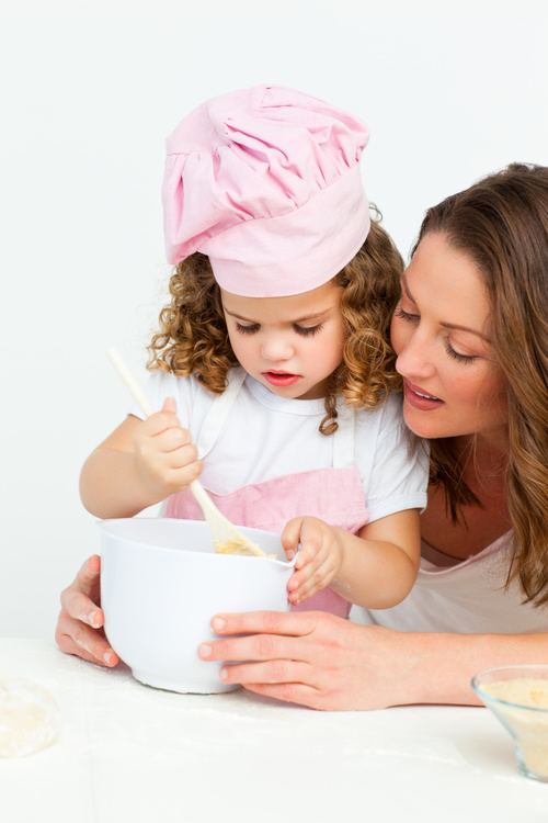 Mother and daughter making cookies together Stock Photo 03