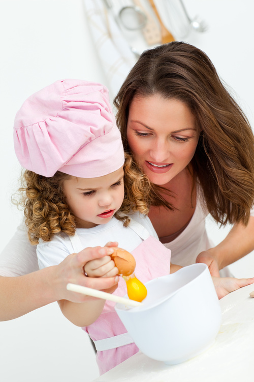Mother and daughter making cookies together Stock Photo 04