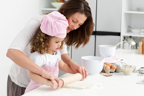 Mother and daughter making cookies together Stock Photo 05