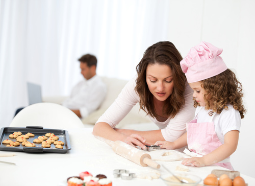 Mother and daughter making cookies together Stock Photo 06