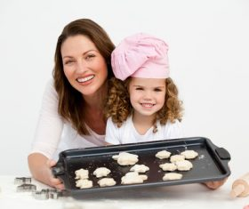 Mother and daughter making cookies together Stock Photo 09