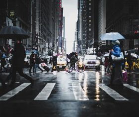 Pedestrians on the street in rainy weather Stock Photo