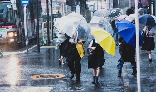 People with umbrellas on the rainy streets Stock Photo 01