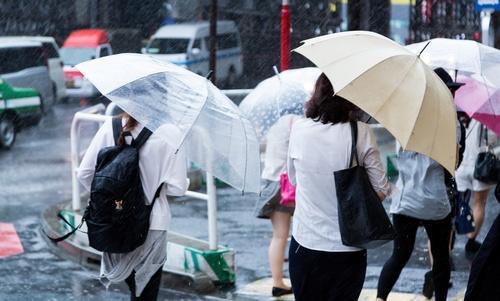 People with umbrellas on the rainy streets Stock Photo 03