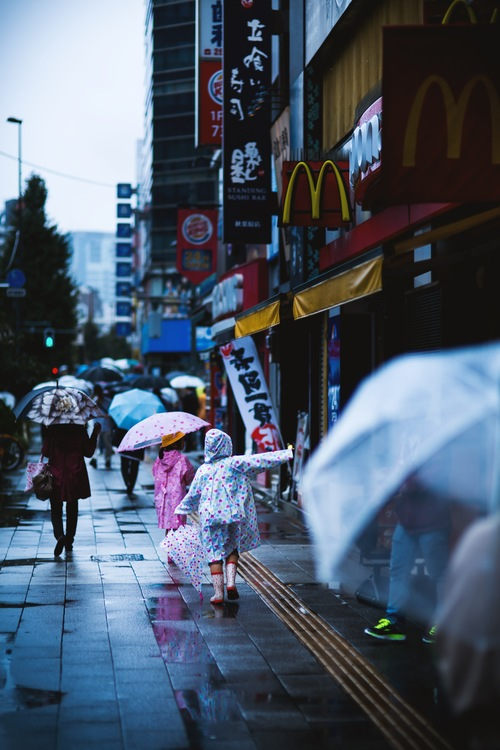 People with umbrellas on the rainy streets Stock Photo 05