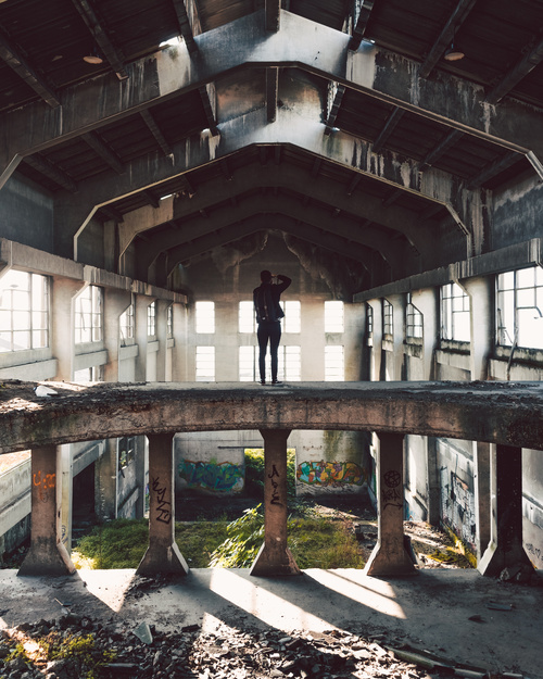 Photographer in abandoned house Stock Photo