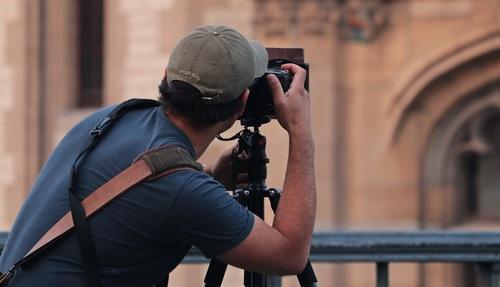 Photographer shooting building Stock Photo