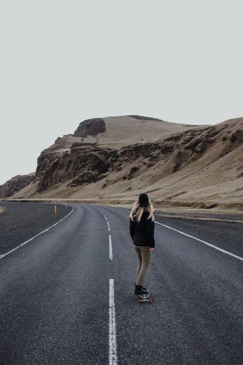 Play skateboarding girl on the road Stock Photo