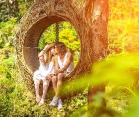 Romantic lovers on swing Stock Photo