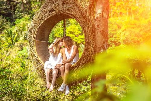 Romantic lovers on swing Stock Photo