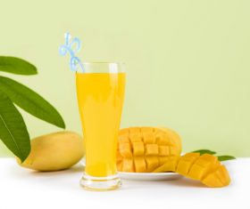 Sliced mango and freshly squeezed mango juice Stock Photo 01