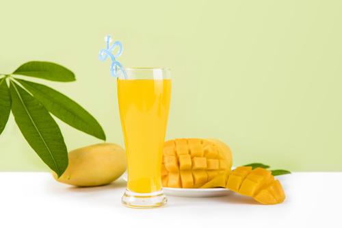 Sliced mango and freshly squeezed mango juice Stock Photo 01
