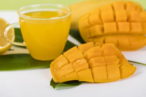 Sliced mango and freshly squeezed mango juice Stock Photo 02