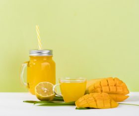 Sliced mango and freshly squeezed mango juice Stock Photo 03