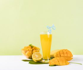Sliced mango and freshly squeezed mango juice Stock Photo 04
