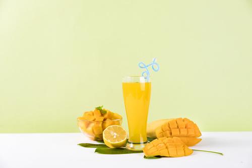 Sliced mango and freshly squeezed mango juice Stock Photo 04