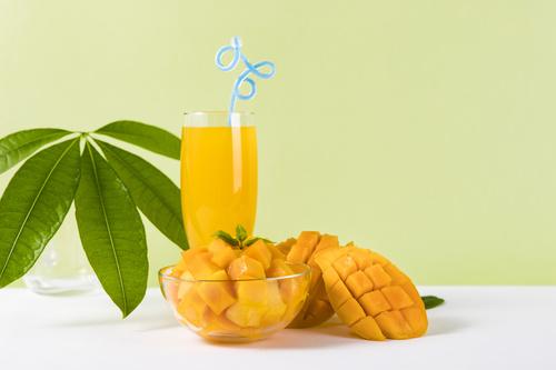 Sliced mango and freshly squeezed mango juice Stock Photo 05