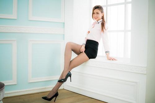 Slim girl with professional uniform Stock Photo