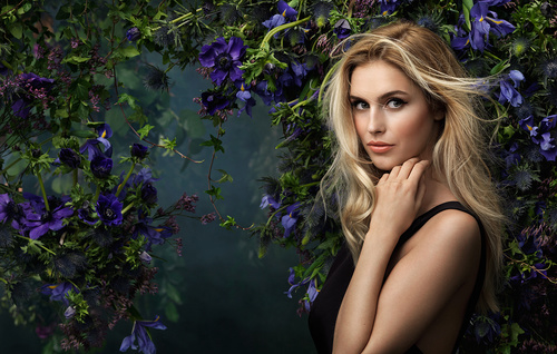 Smiling beautiful woman with different flowers background Stock Photo 02