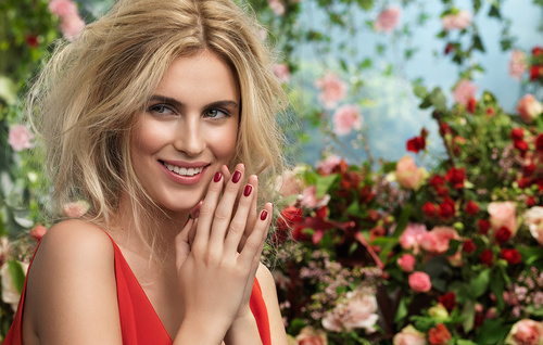 Smiling beautiful woman with different flowers background Stock Photo 03